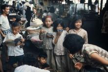 Sài Gòn tuổi thơ, kỷ niệm đồng tiền xé đôi thối lại