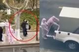 """Video: Đôi vợ chồng bị """"đóng thùng"""" cách ly ngay trên phố vì nghi nhiễm dịch"""